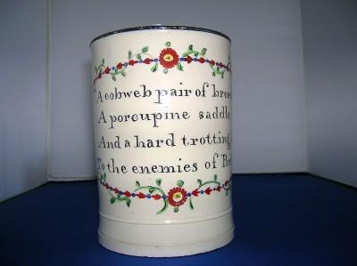 "A satyrical creamware mug "" cobweb pair of breeches"